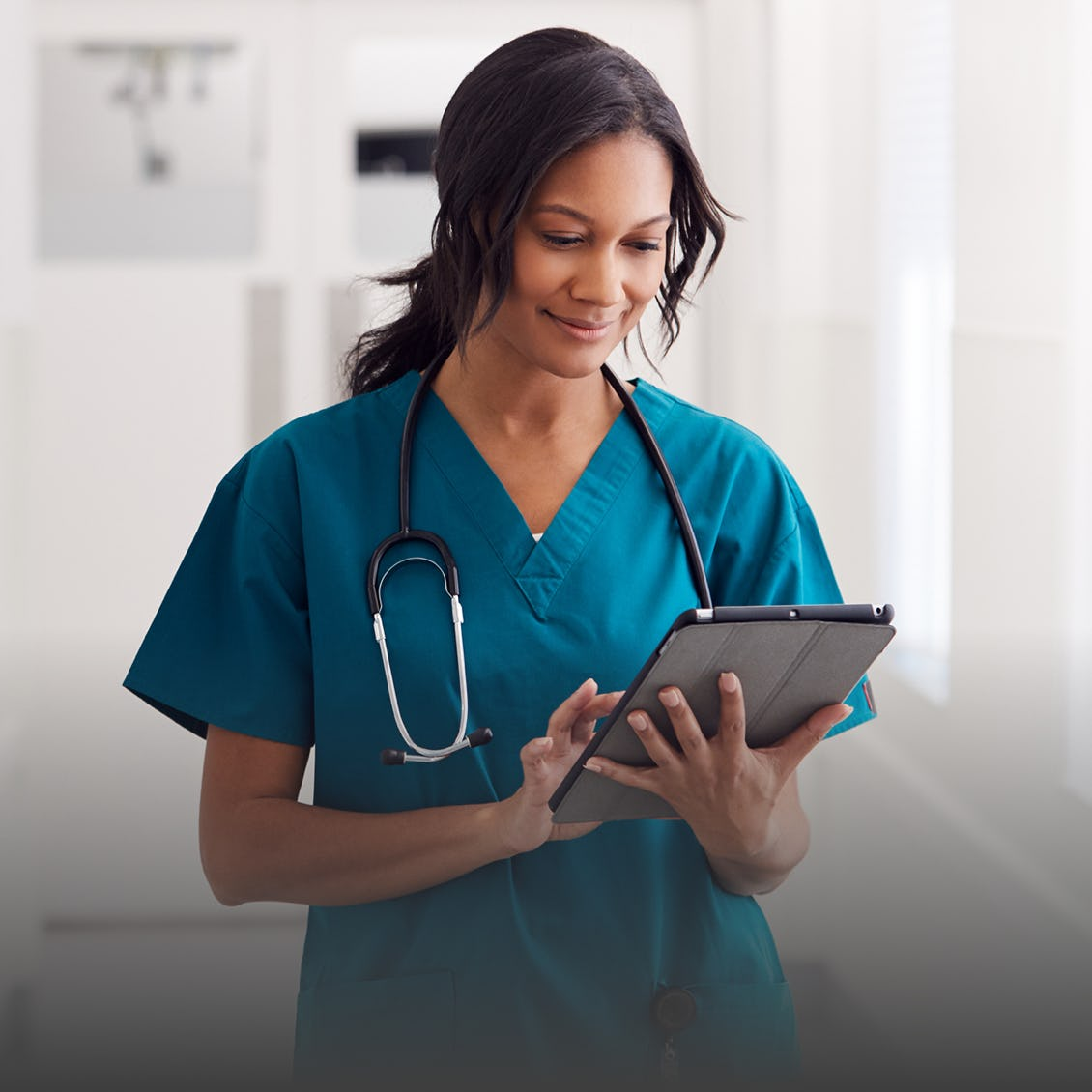 a doctor looking at the Cleveland site on her tablet