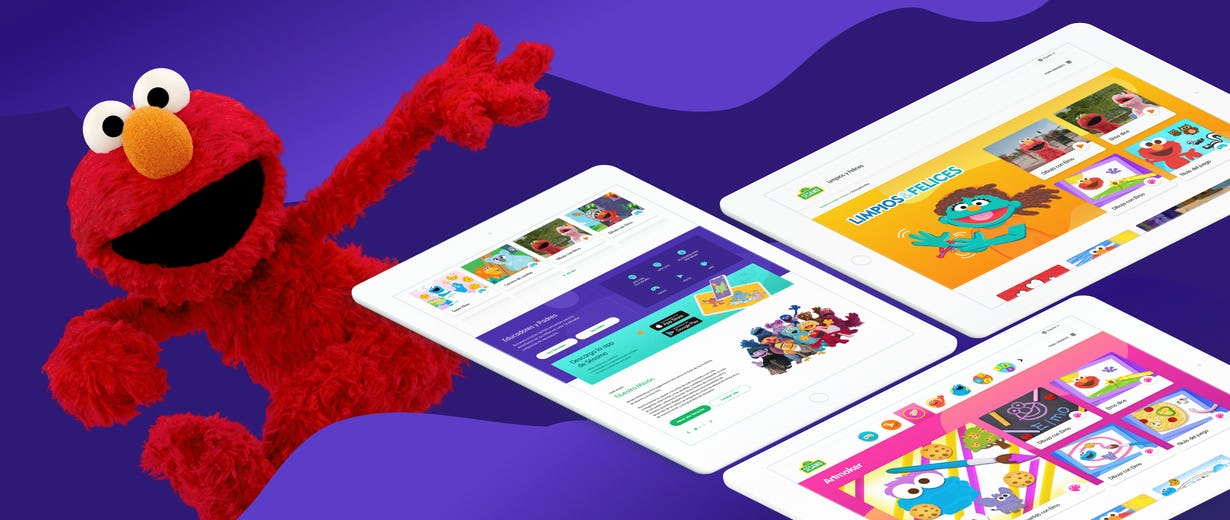 Elmo in a purple background with three tablets showing the Sesame site