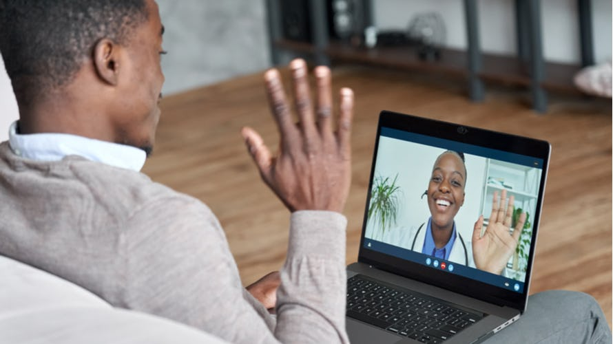 A man on a virtual conference with his doctor