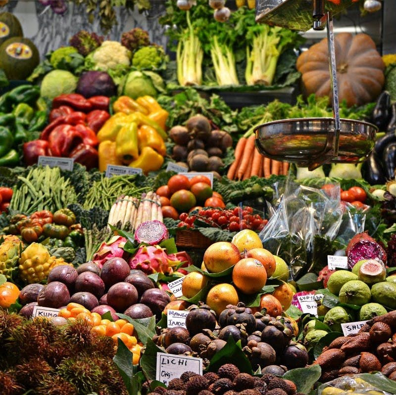 A variety of colorful vegetables displayed at a market stall.