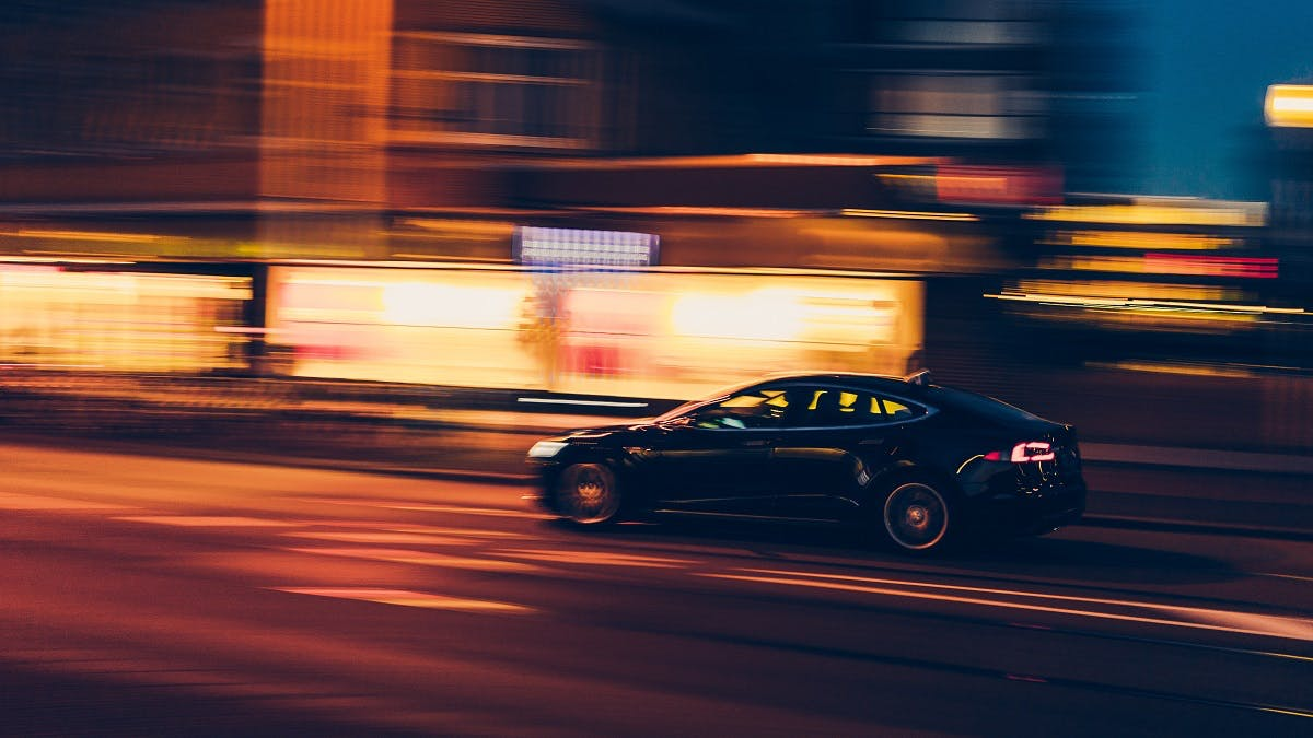 An electric car whizzing through town
