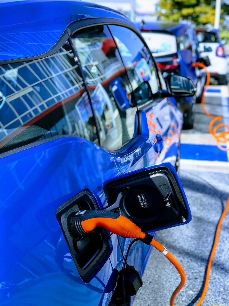 Two BEV electric vehicles charging