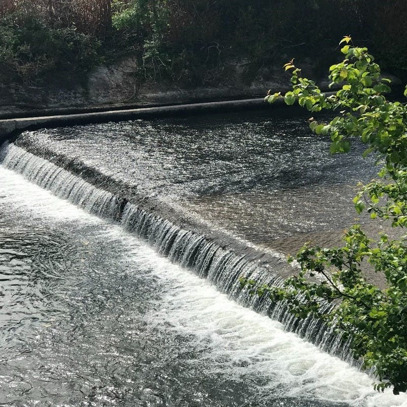 A weir or low dam regulating water flow.