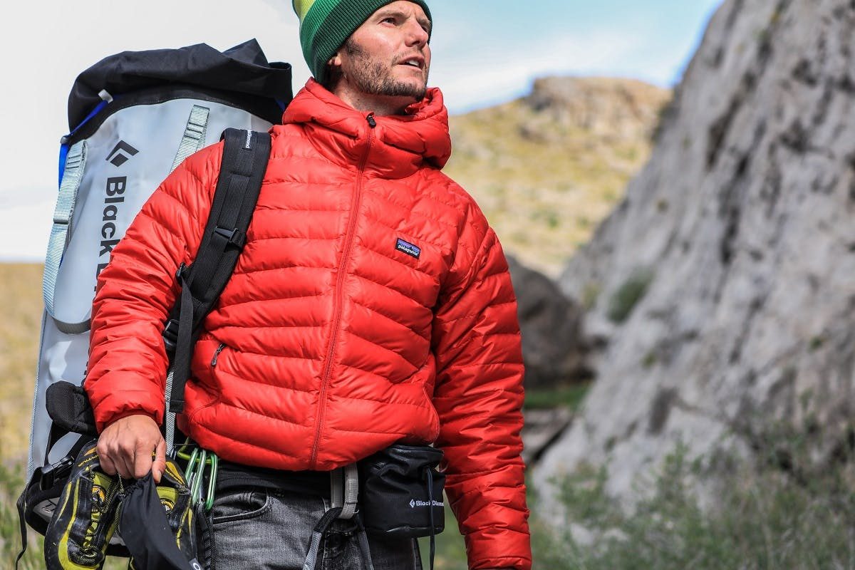 A climber at the crag with climbing gear wearing a sustainable fashion brand.
