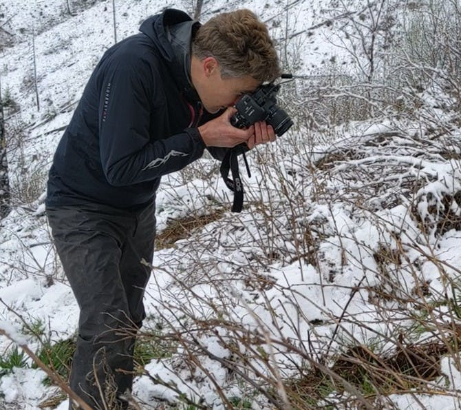 Co-founder Matt takes photos of freshly planted trees after a snowy planting session.
