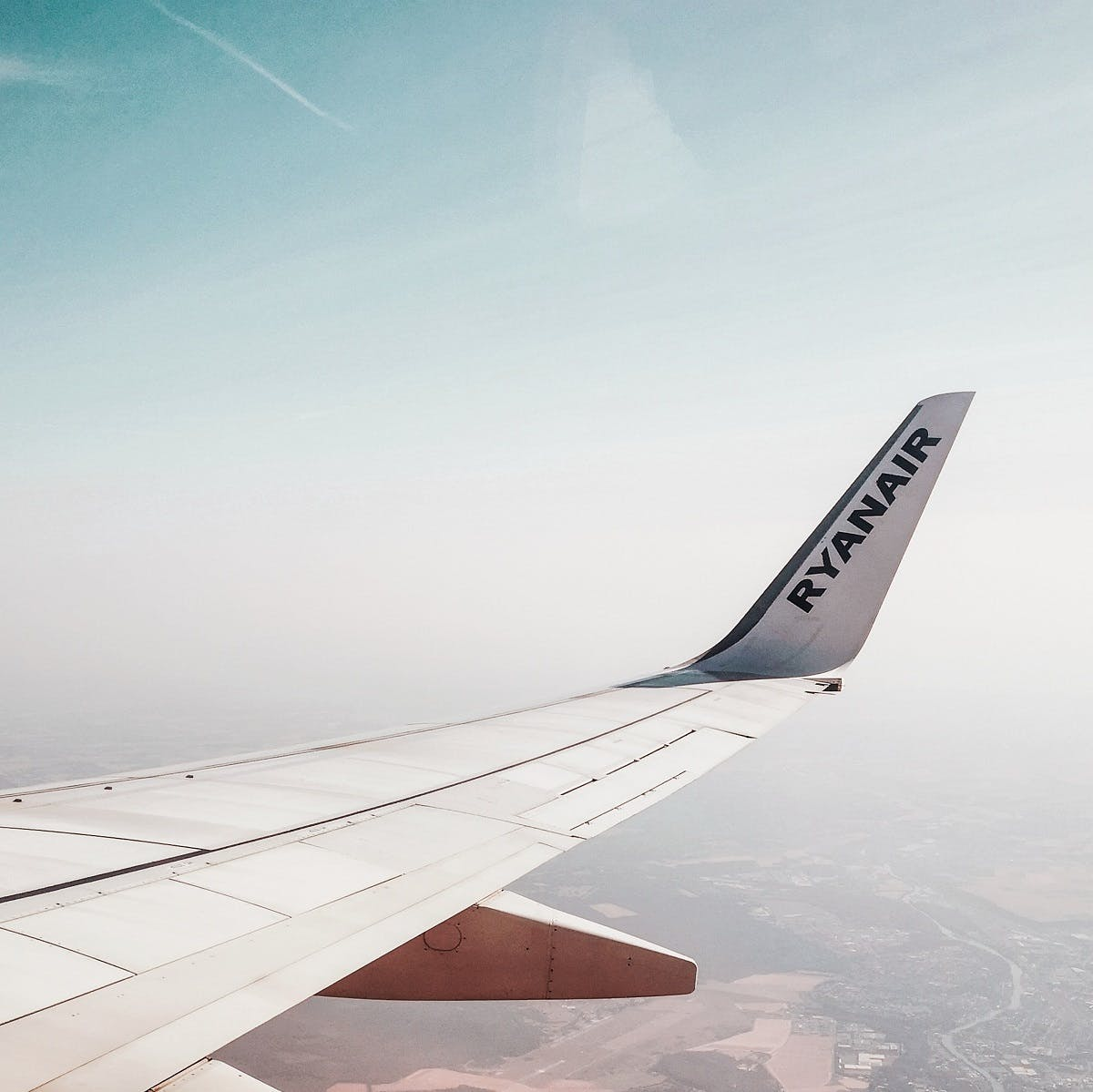 A view of the wing and winglets of a Ryanair plane from inside the cabin. The use of winglets contributes to more sustainable flying.