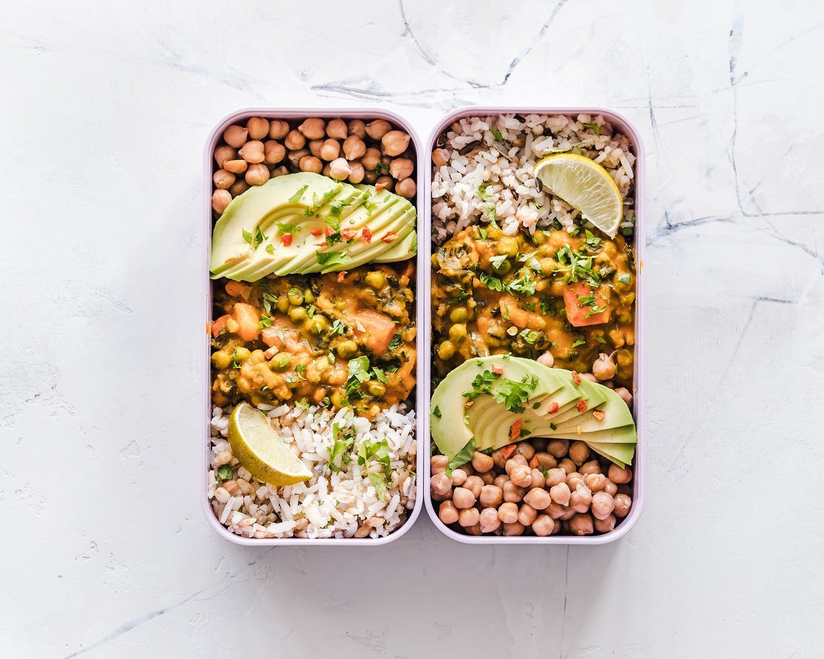 Being vegan is about being prepared. Here is vegan packed lunch box of curried chick peas, brown rice and avocado.
