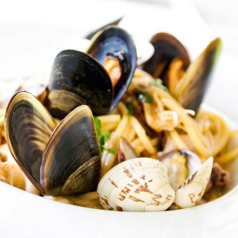 A delicious looking plate of mussels and pasta. Microfibres and microplastics are now being found in shellfish