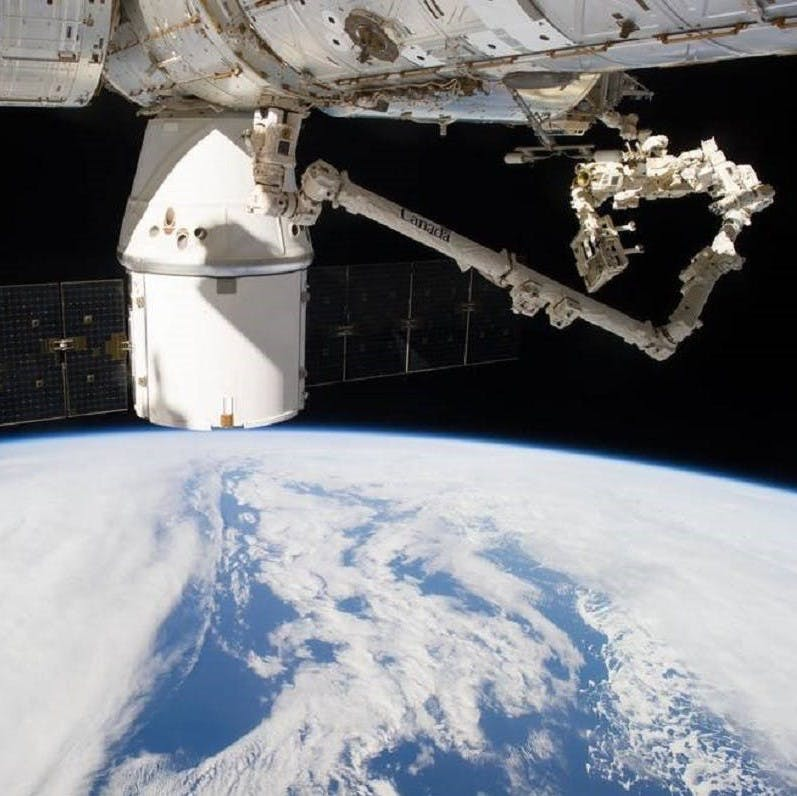 SpaceX dragon capsule docking with the International Space Station. The data collected from this mission will inform carbon sequestration estimates of above ground biomass around the world.