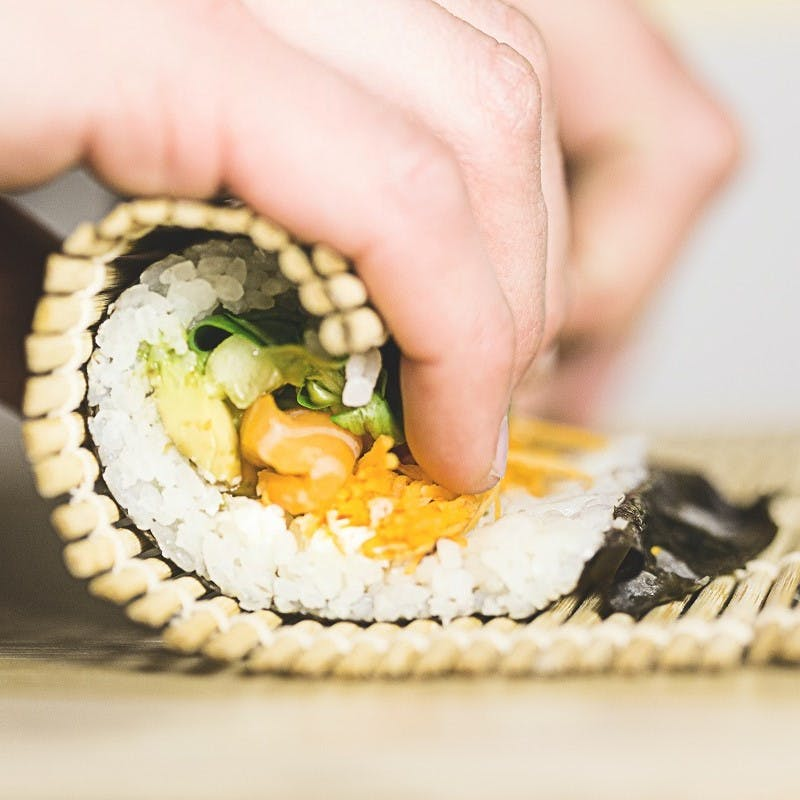 Sushi being made at home. Sushi is often a faveourite for pescatarians
