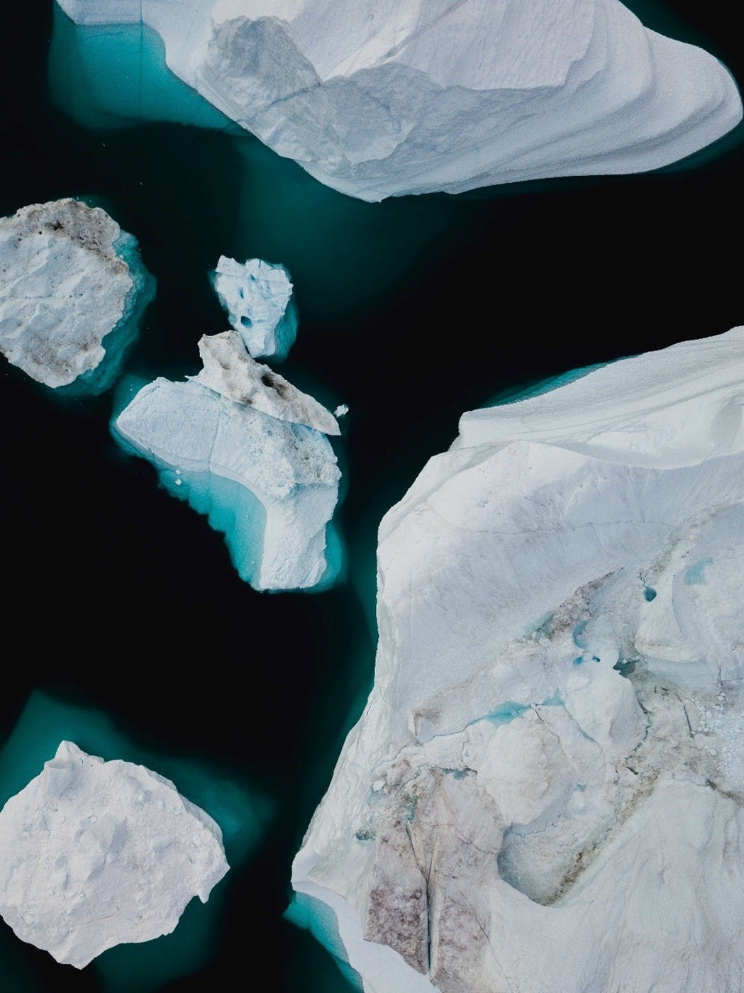 An impressive aerial image of floating sea ice. Climate change is causing a loss, on average, of 150 to 280 billion tons of ice per year in Greenland and Antarctic.