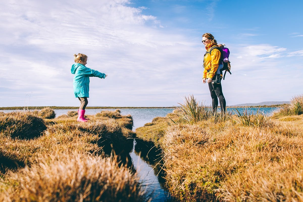 A mother and daughter out in the countryside. Getting outside and into nature is key to battling eco anxiety.