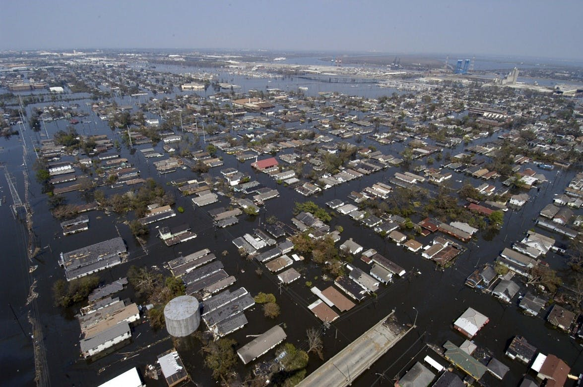 An aerial view of a flooded town. As climate change worsens, we are witnessing ever more floods, that are ever more severe.