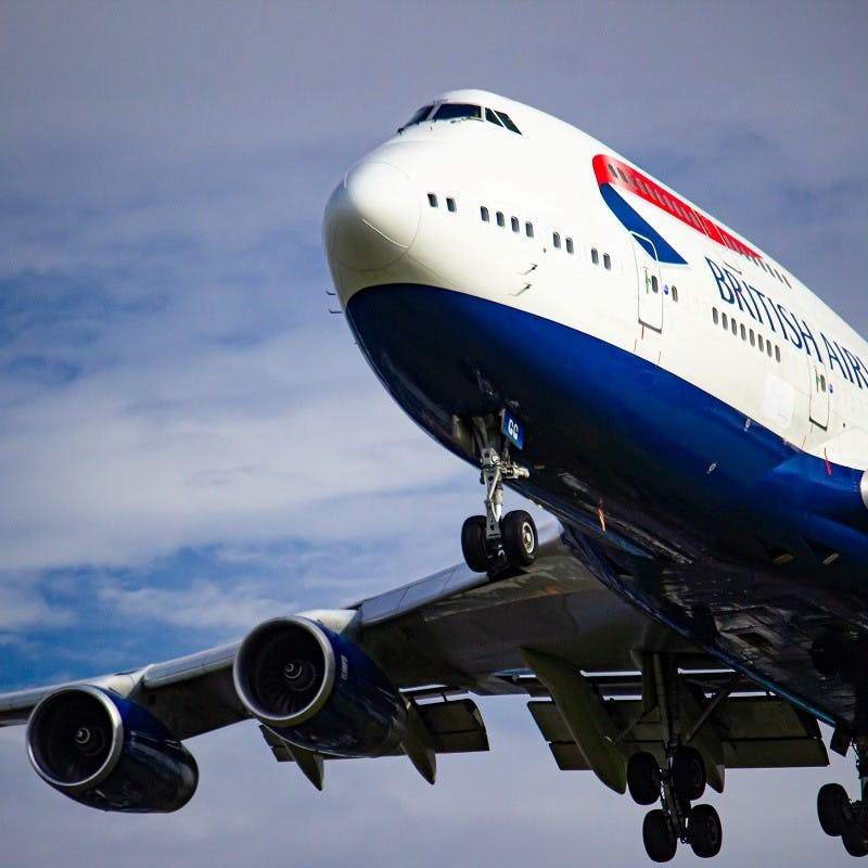 A British Airways Boeing 747 coming into land . To ensure more sustainable air travel, opt for direct flights to minimise the additional fuel heavy take offs and landings.