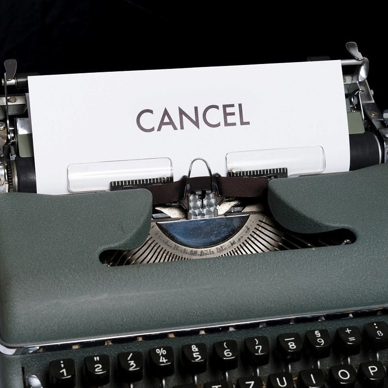 An old typewriter with a paper titled cancel. Cancelling your flight ticket if you can't go, is key to sustainable flying as it means the same seat can be re-sold and not fly empty.