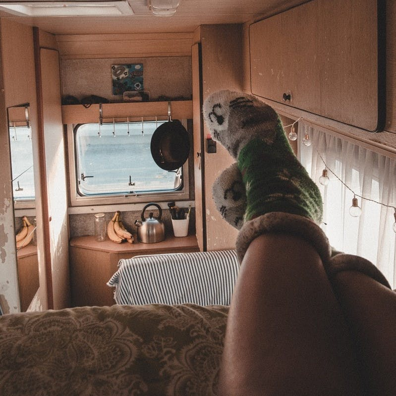 A lady relaxing inside her camper van. #vanlife