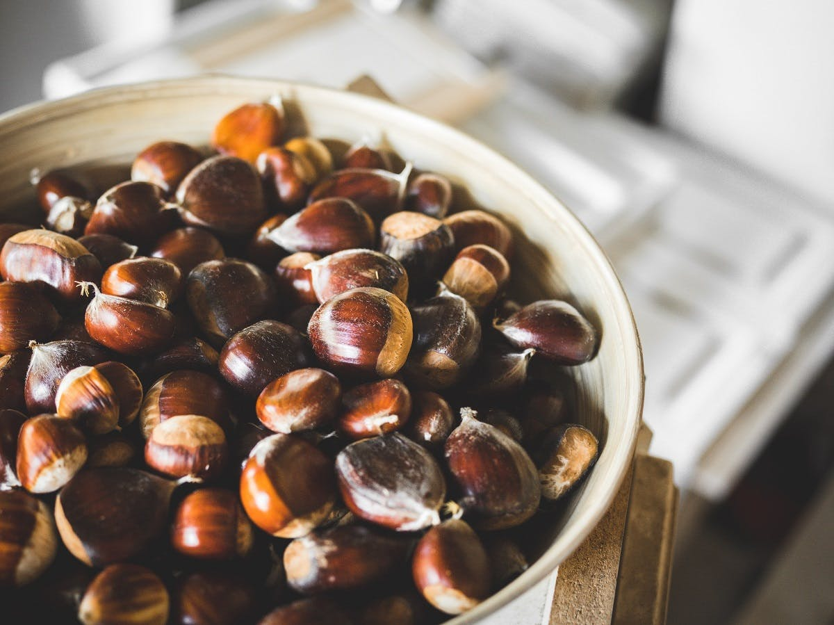 A bowl of chestnuts. Roasting chestnuts is an easy first step to eating seasonally and locally