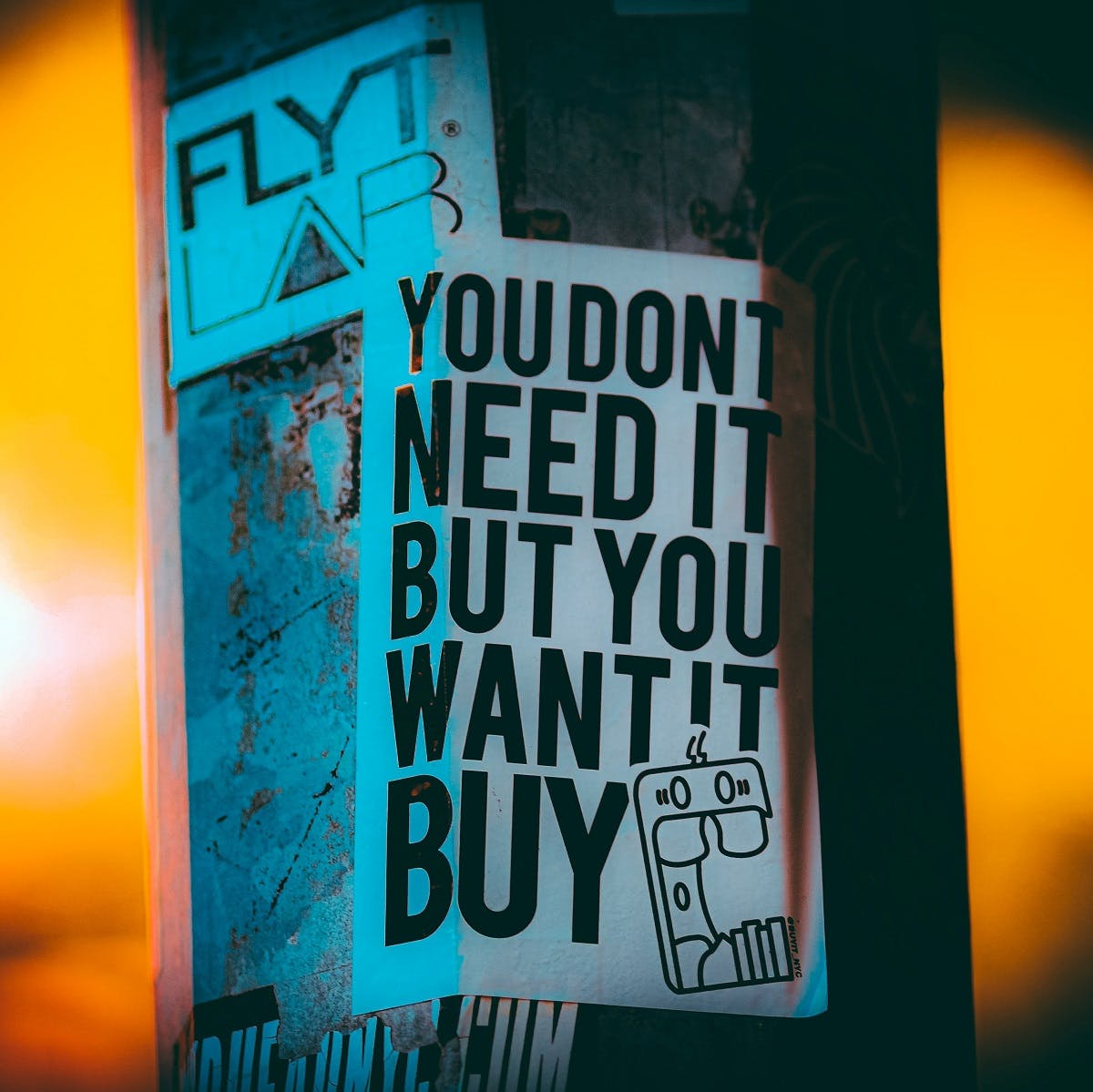 A pro consumerism sign. A circular economy draws away from consumerism culture