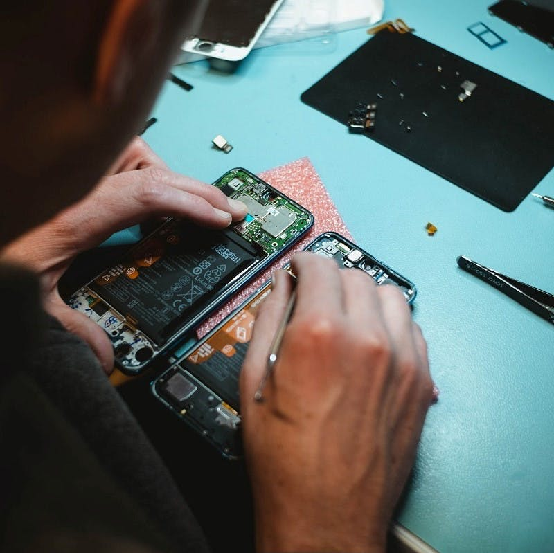 A mobile phone being repaired. Repairing used items comes under tier five (Materials Recover) of the Zero waste hierarchy.