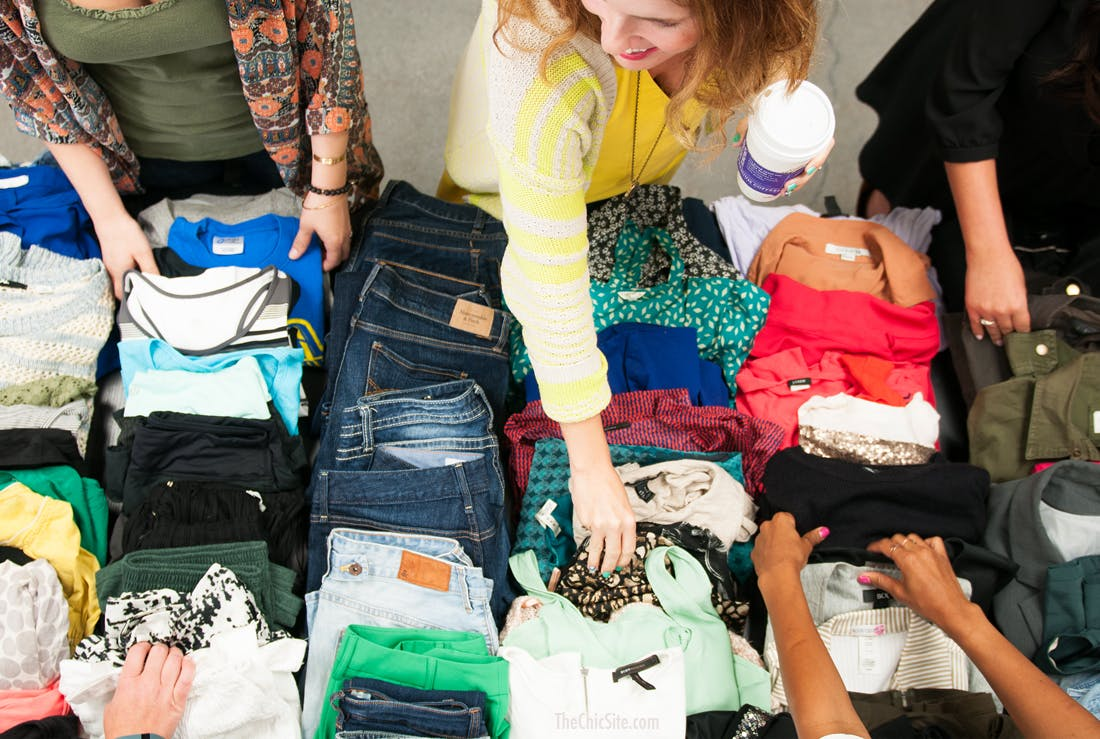 Work colleagues take part in a second hand clothes swap event