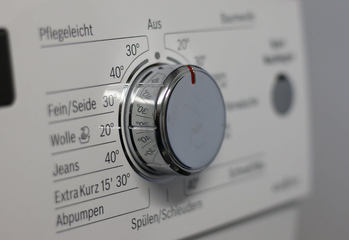 A close up image of a washing machine's different temperature settings.