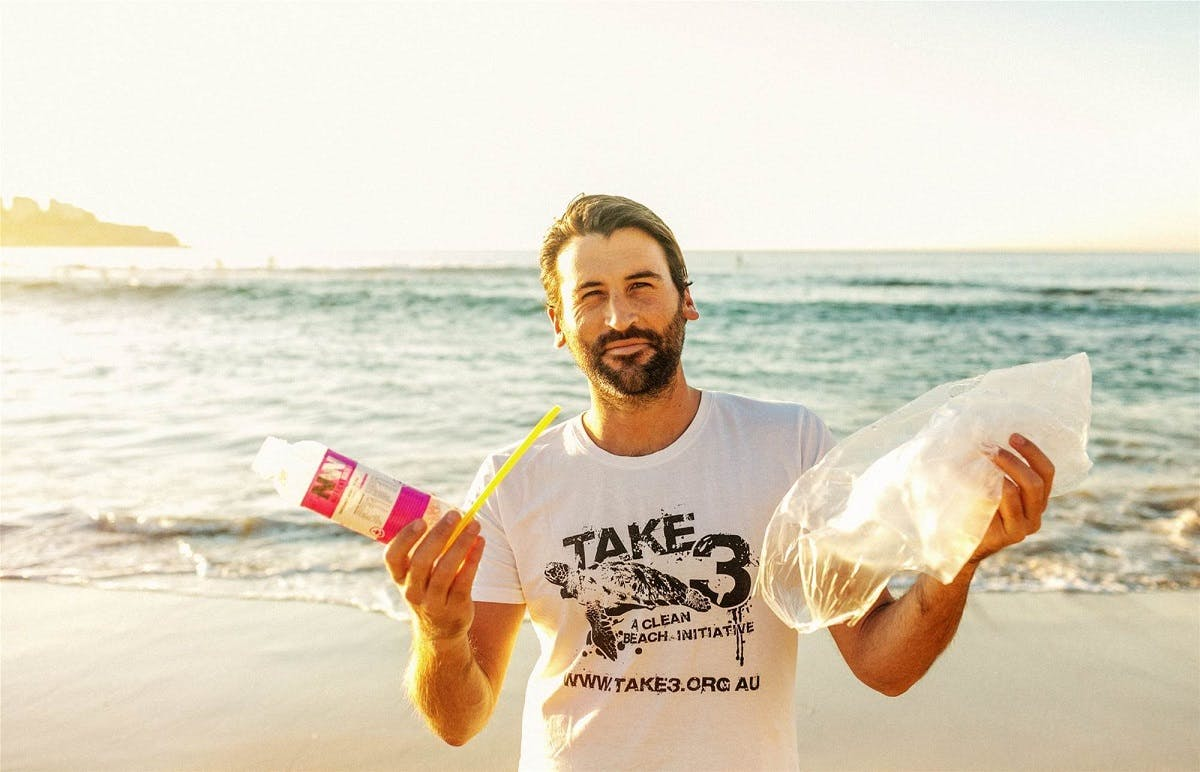 A man collecting litter from his local beach.