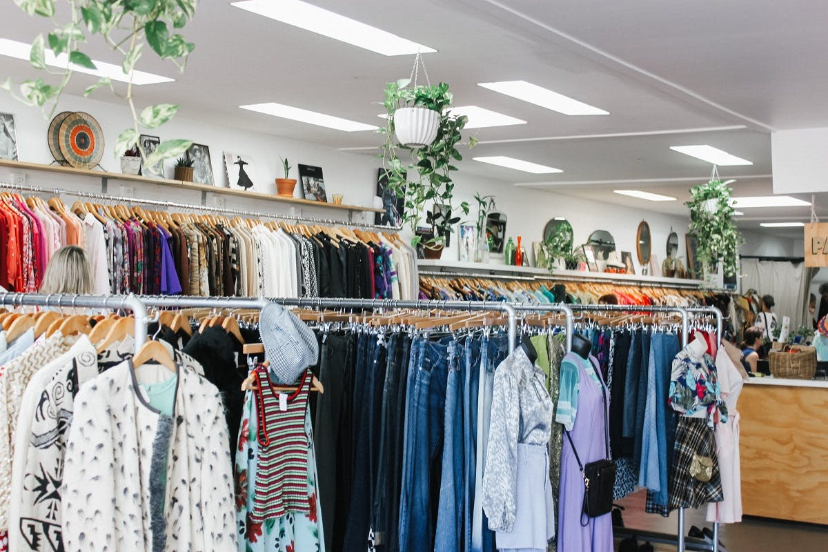 A high street charity shop selling pre-owned clothing