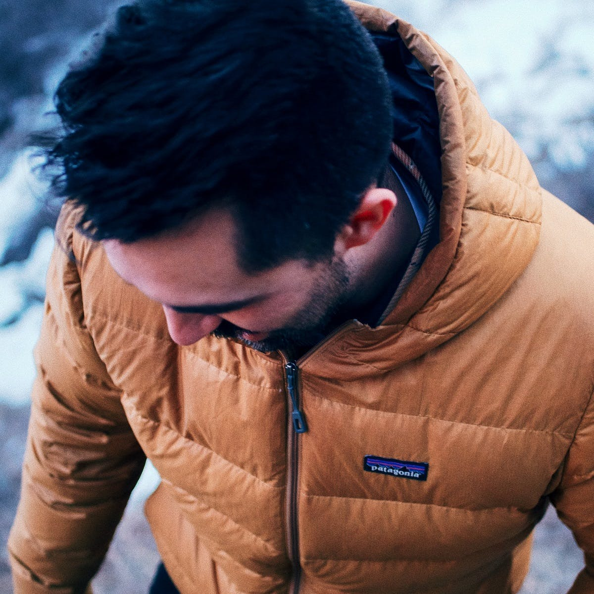 A man wearing a Patagonia jacket. Patagonia are advocates of a circular economy