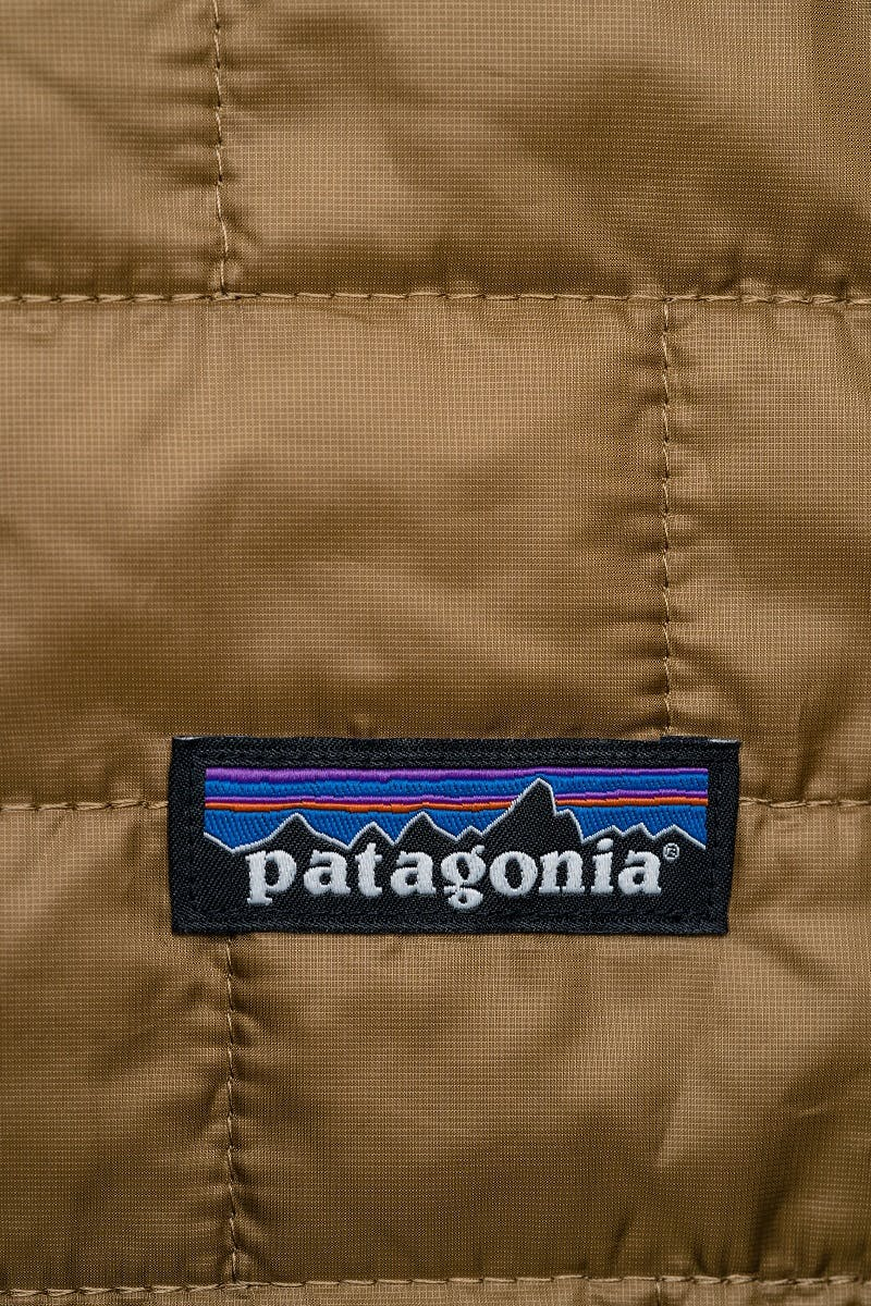 An item of clothing with a Patagonia badge stitched on.