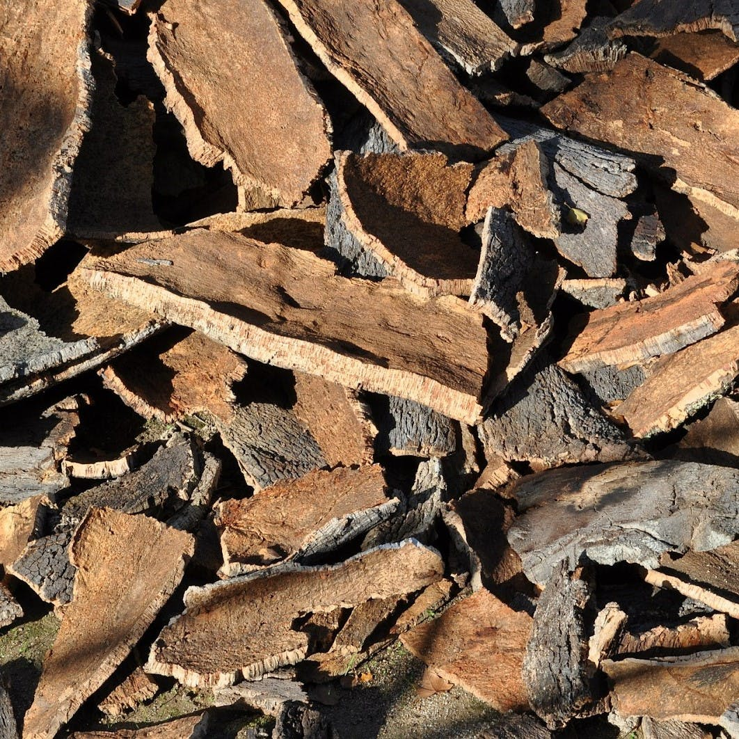 A pile of cork tree bark. Cork is an eco friendly alternative to home insulation.