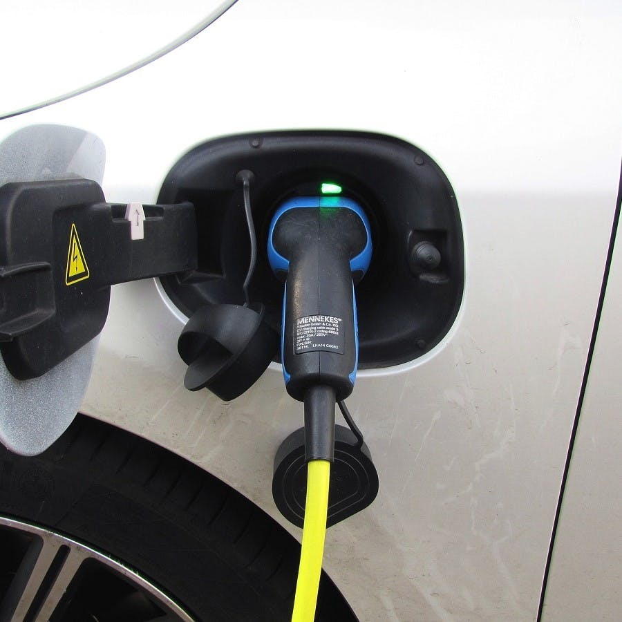 A hybrid car charging up its battery