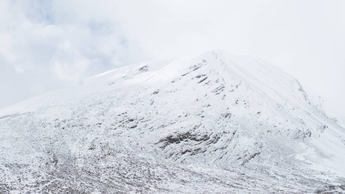 A lightly snow covered mountain. With warming temperatures and less snow cover, Scottish mountain hares are more vulnerable to predation in winter