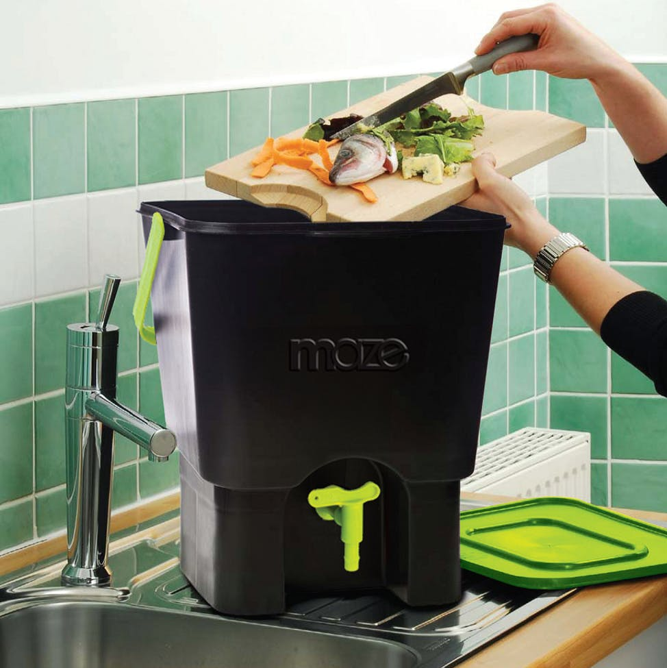 A black and green maze kitchen composter