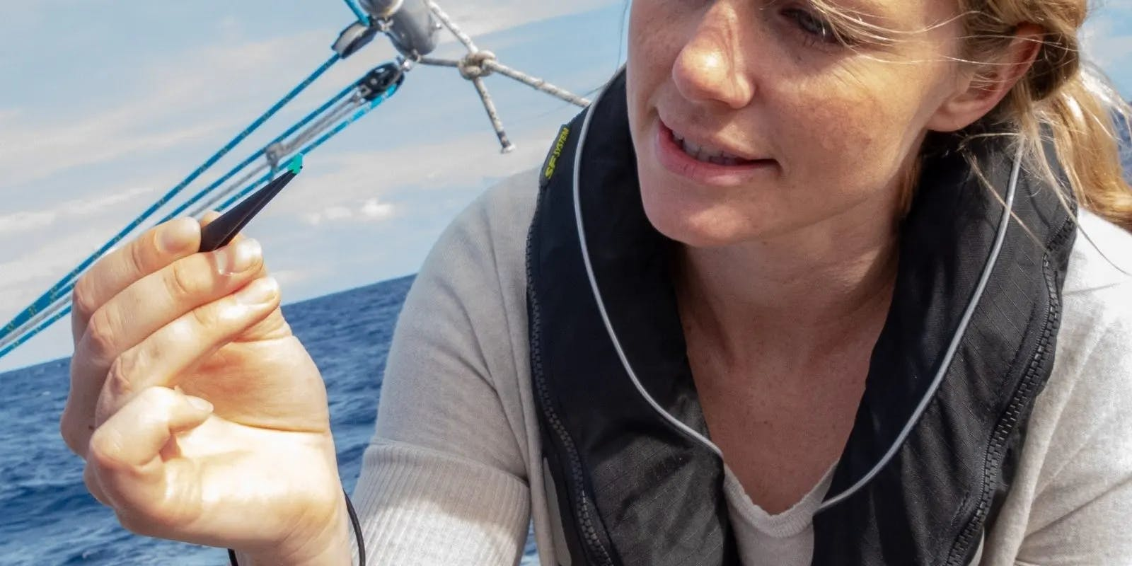 A lady investigating ocean plastics and microfibres on board a research yacht