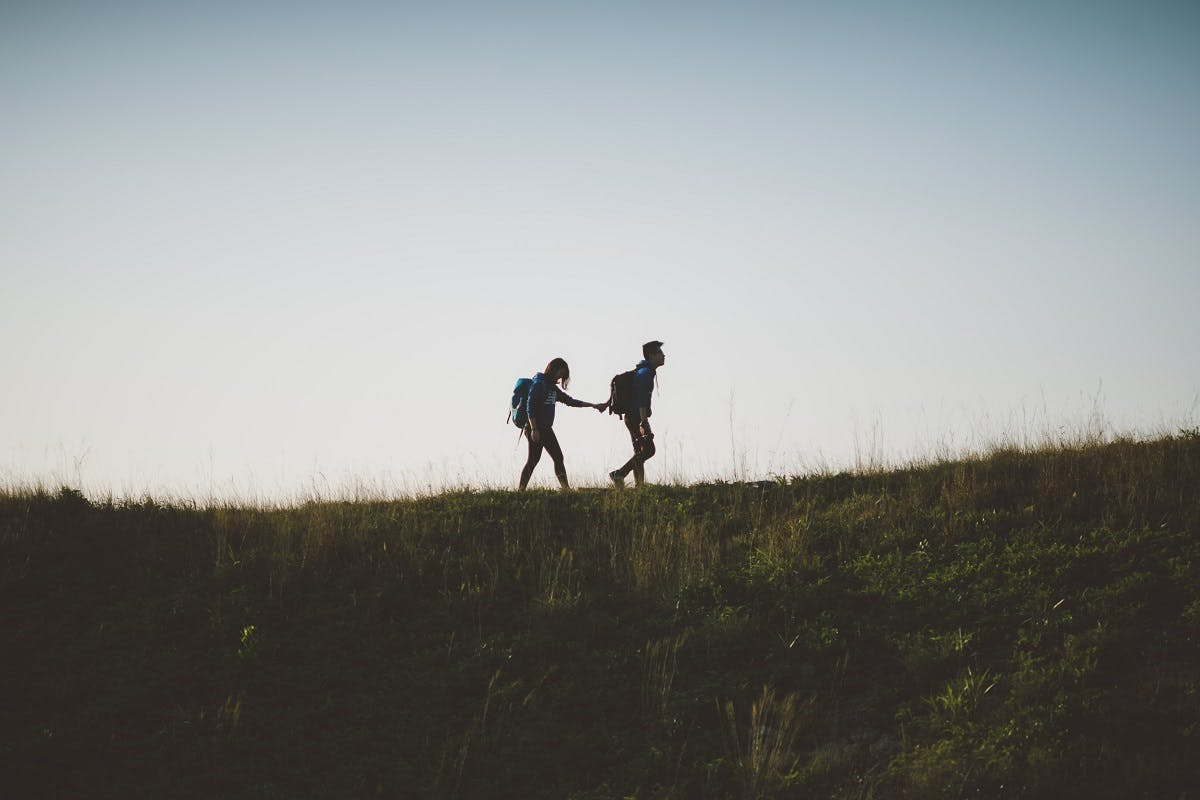 A couple walking in nature.