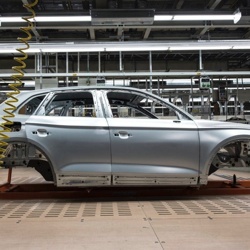 The chassis of a car at an assembly line.
