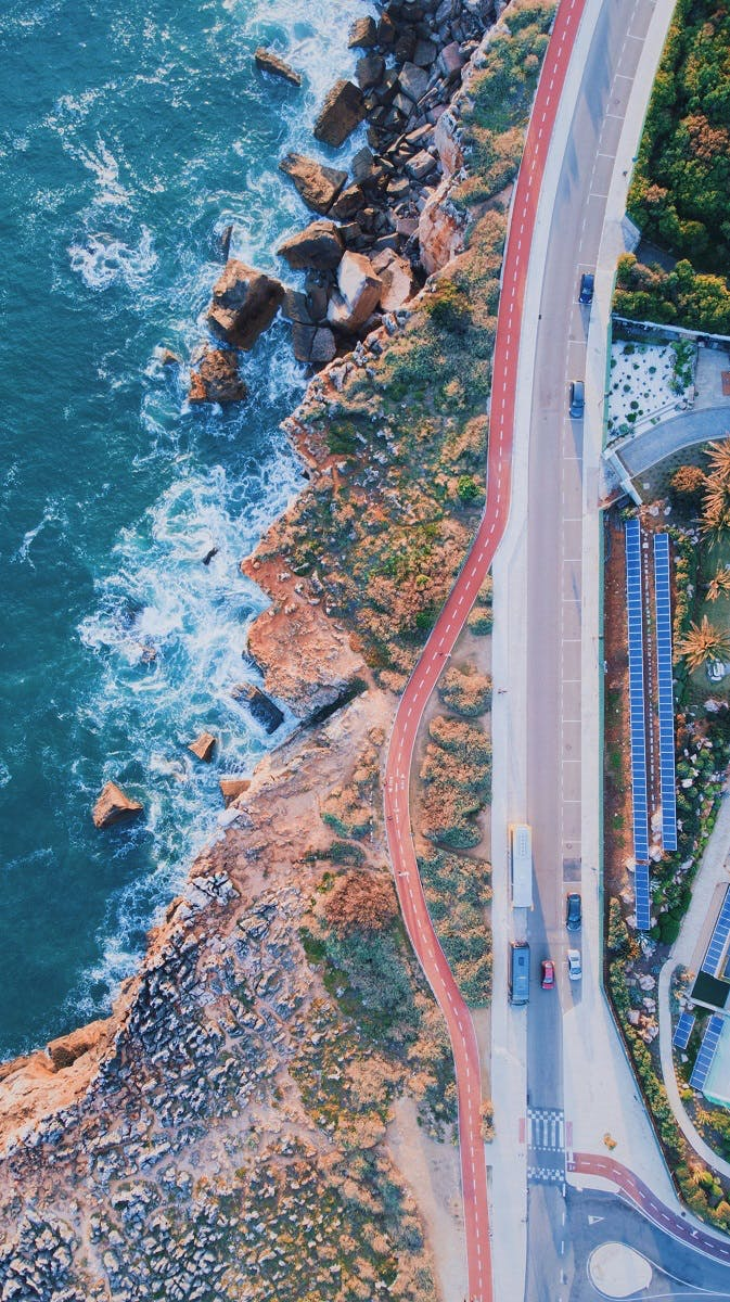 An aerial view of a cycle lane by the coast in Cascais. Many people use this lane to green commute to and from Cascais, Portugal.