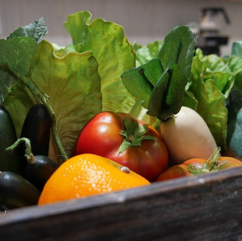 A veg box containing a variety of fresh, seasonal and local fruit and vegetables. A veg box is an simple and convenient way to eat the seasons and eat locally.