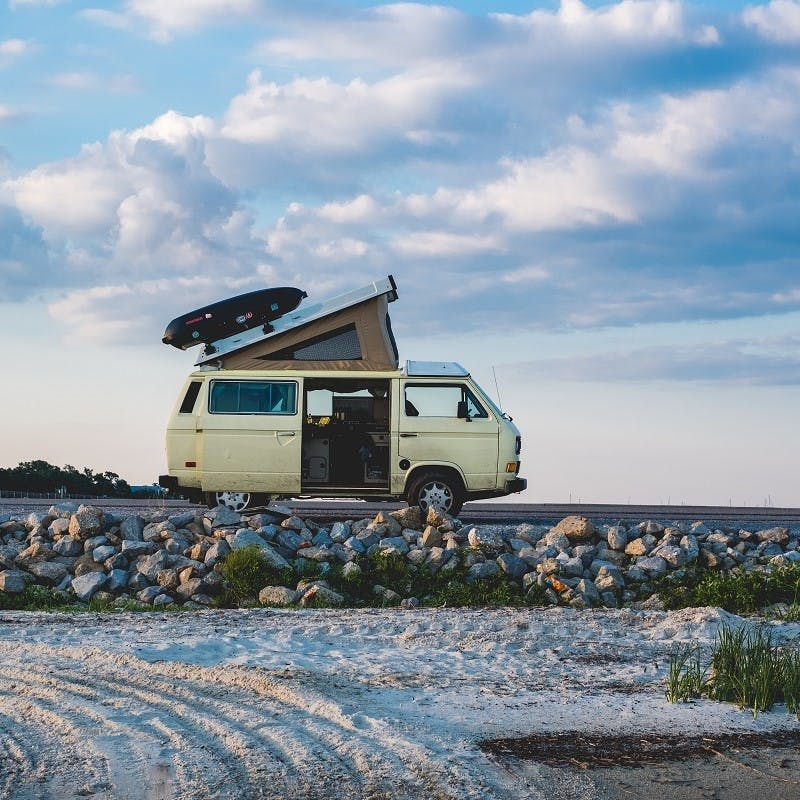 An old VW transporter parked at the beach
