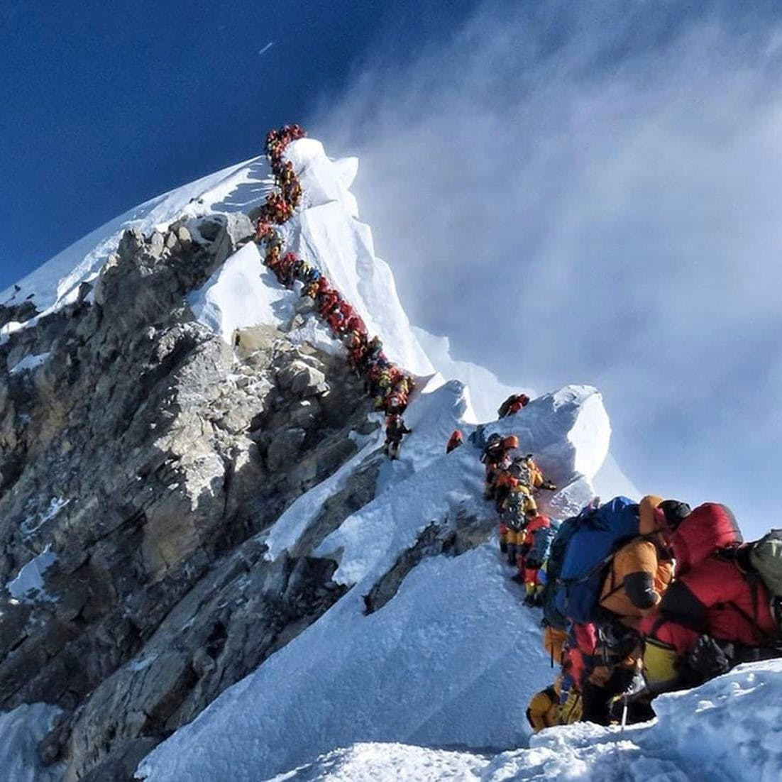 A dangerously long queue of climbers at the summit of Mount Everest. This is definitely not responsible travel!