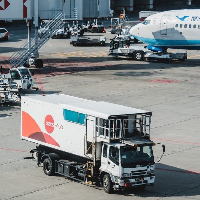 A food delivery lorry at an airport. Airports are one place that definitely need to learn how to reduce food waste.