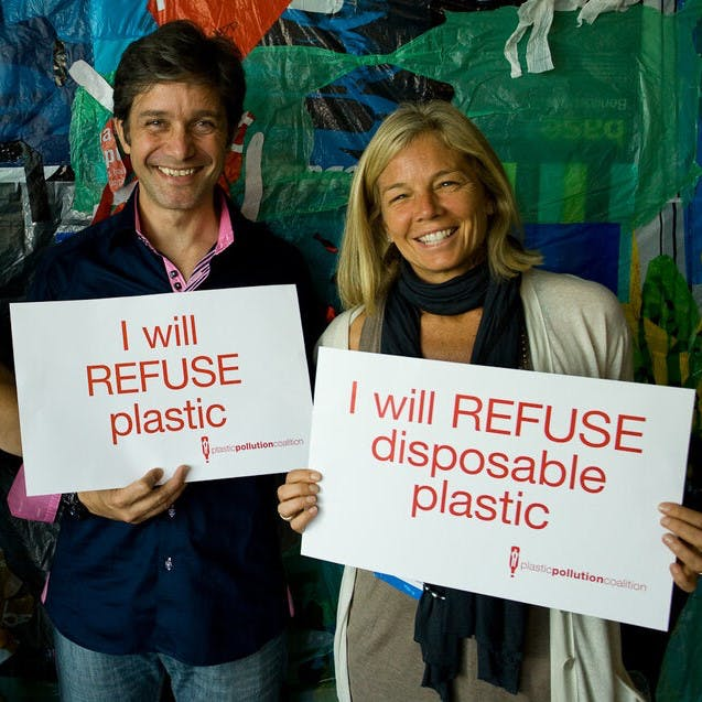 Two people promising to refuse single use plastic