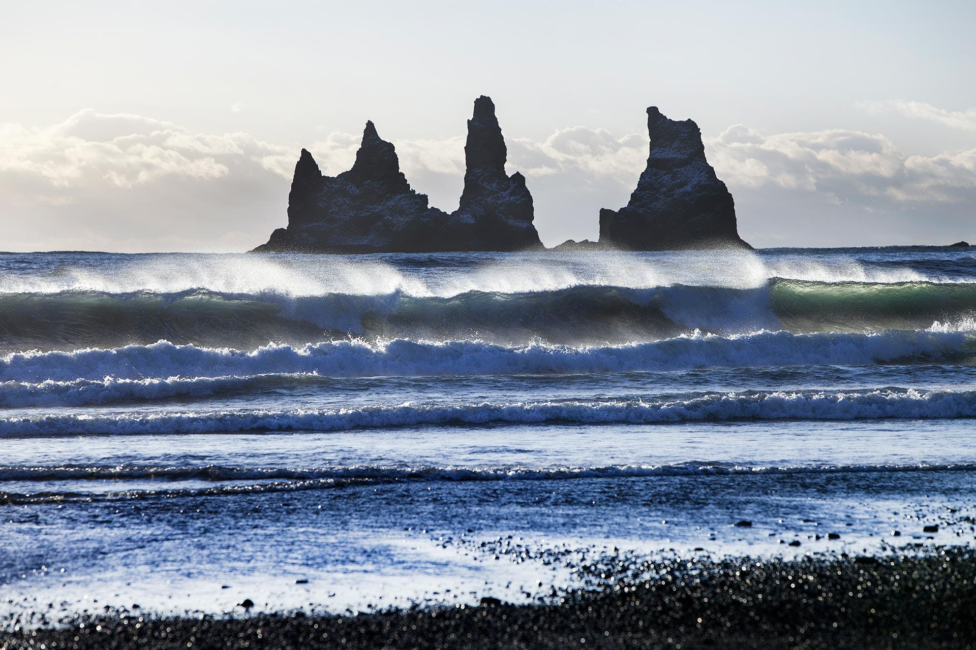Reynisdrangar cliffs rising from the ocean