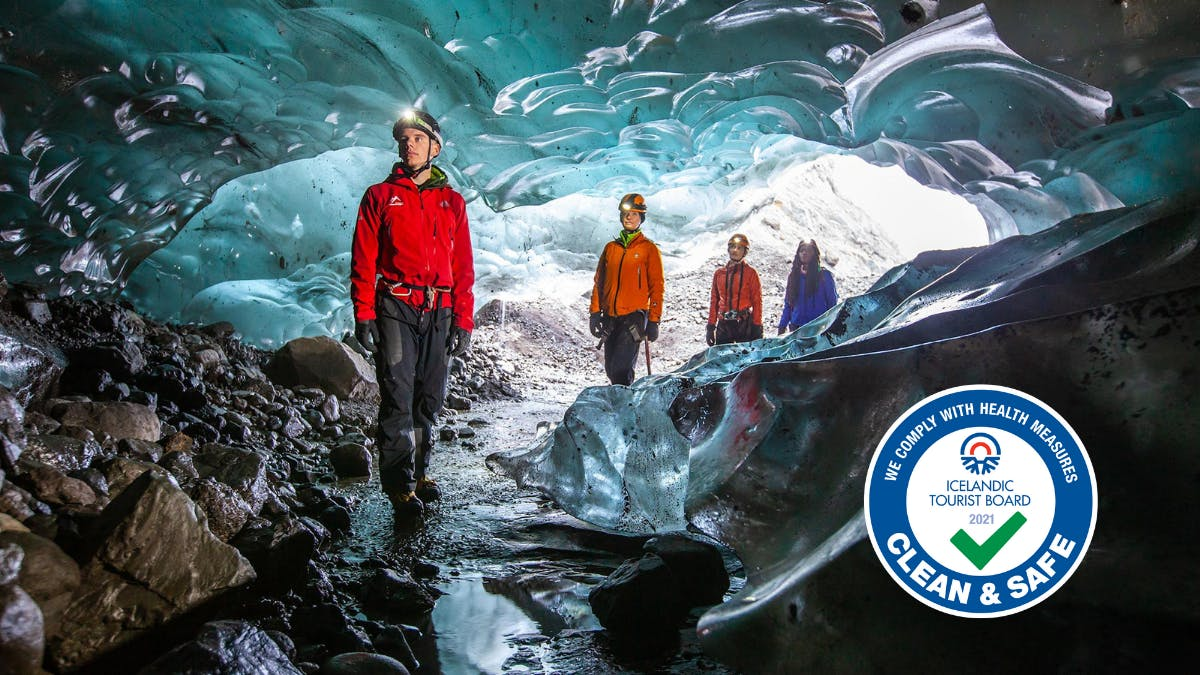 Glacier guide with a group in an ice cave.