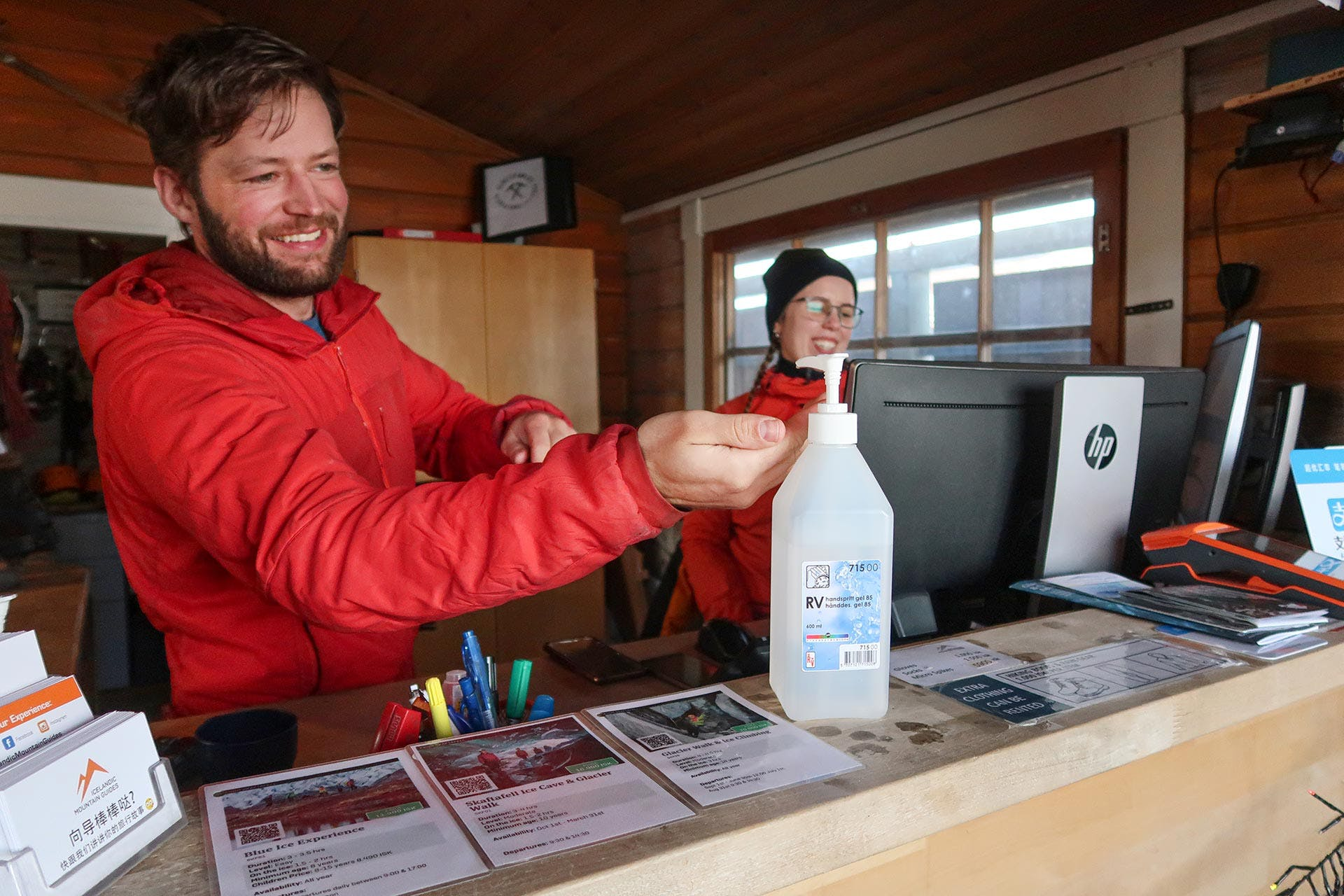 A guide disinfecting his hands before guiding a tour.