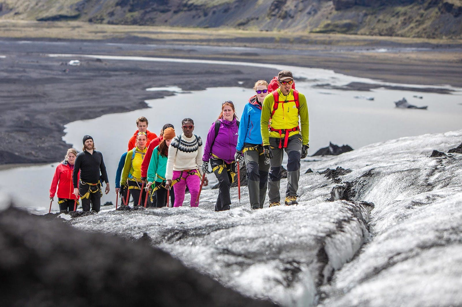 Group of people hiking an glacier