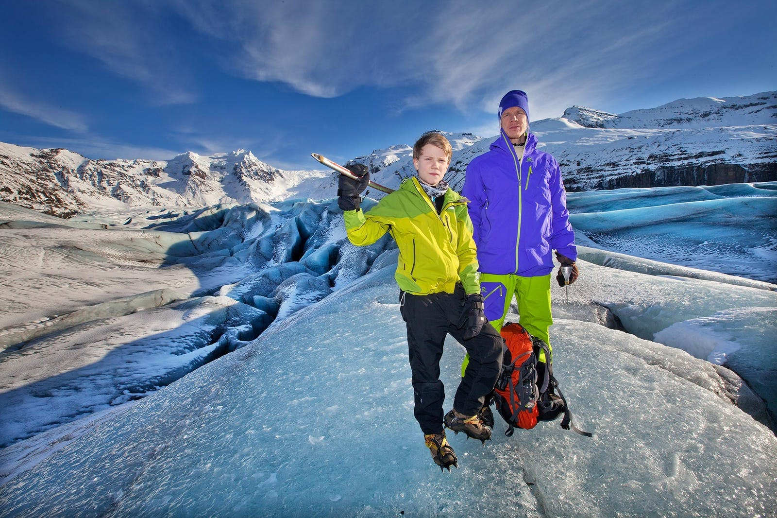 A boy and his father standing on Svínafellsjökull glacier doing a glacier walk with Icelandic Mountainguides