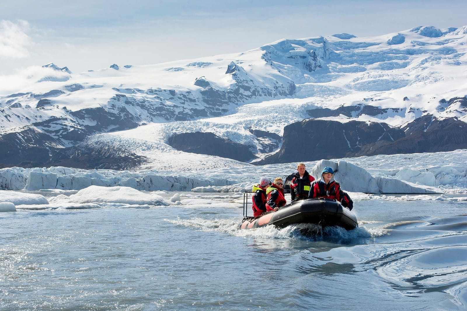 people sailing through the glacier lagoon of Vatnajokull