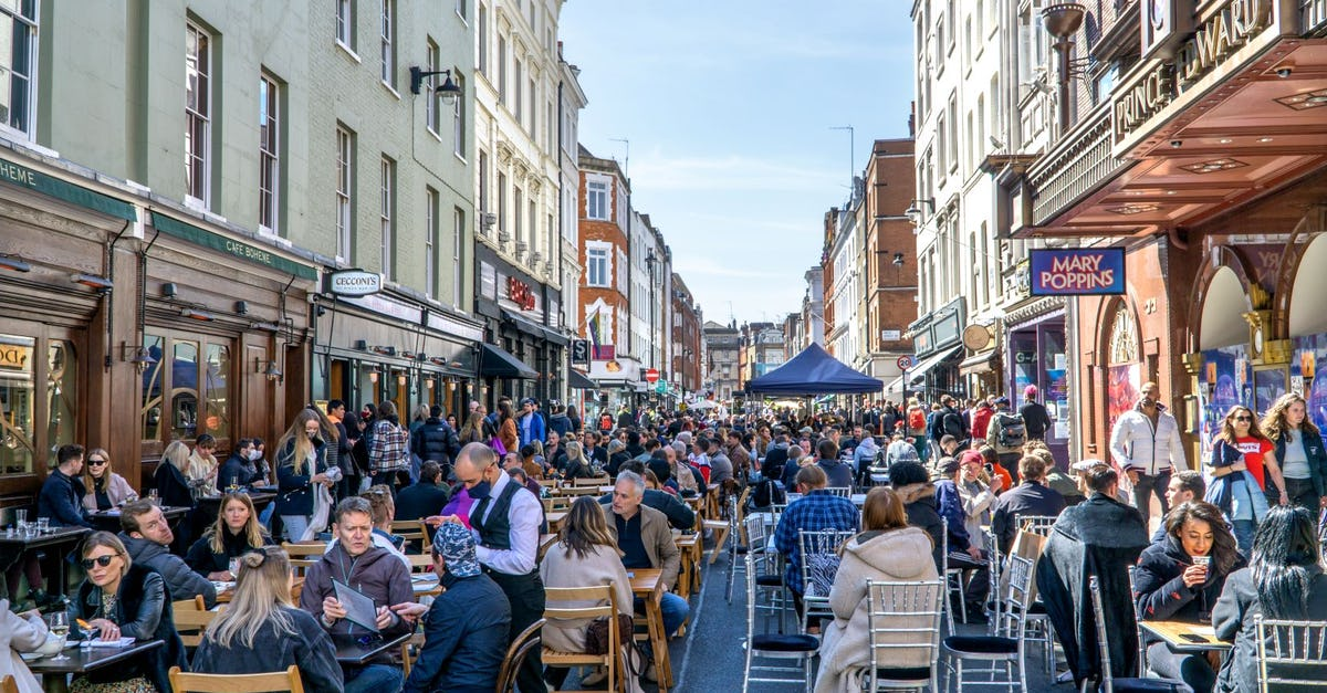 London, UK - 18 April 2021: Outdoor drinking and dining outside pubs on Old Compton Street, Soho, central London