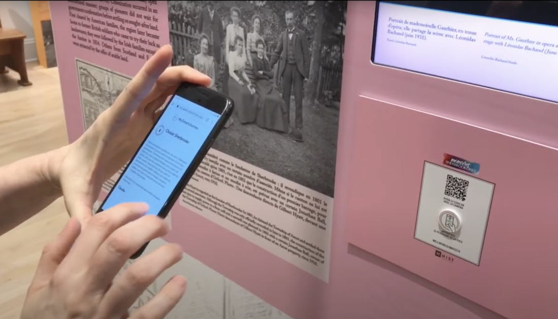 A person scans a QR code at the Sherbrooke History Museum